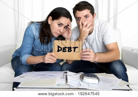 young couple worried need help in stress at home living room couch accounting debt bills bank papers expenses and payments feeling desperate in bad financial situation and bankruptcy
