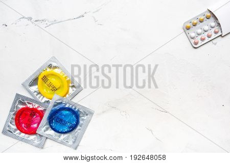 male contraception with condom on white table background top view space for text