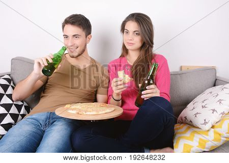 Couple Eating And Watch Tv.