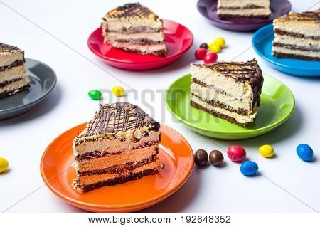 Caramel Cake Slices On Colorful Plates