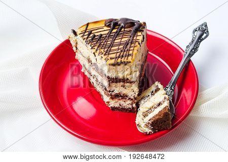 Caramel Chocolate Cake Slice On Red Plate