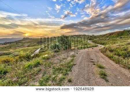 Dirt Road Through Mediterranean Landscape On The Island Of Cyprus