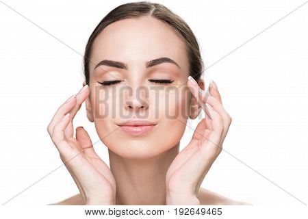Cheerful lady doing make-up with help of foundation. She putting drops on face. Portrait. Isolated