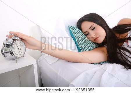 Woman Turning Off Alarm Clock.