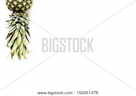 Pineapple on white background top view copyspace.