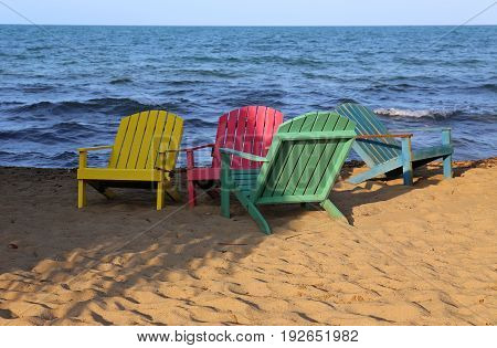 Party colored beach chairs on the sea in Belize