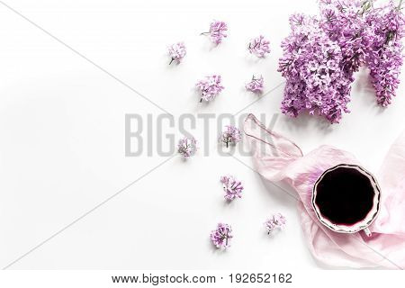 Female work desk with lilac flowers in home office on white background top view space for text
