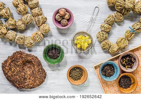 Different kinds of herbal tea on gray wooden table background top view