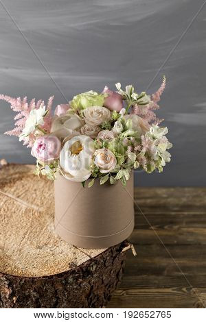 Vintage Still Life With Flowers. mixed color. different flowers gathered in a vase on floral sponge. copy space