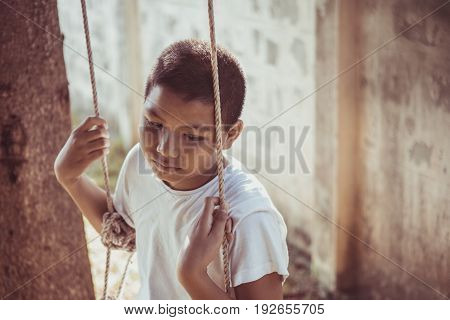 young Asia boy sitting Alone and scared