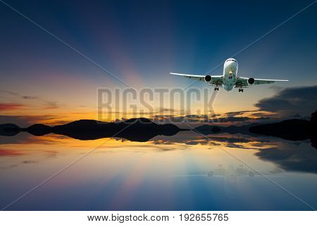 airplane in the sky with reflex beautiful sunsetconcept open season tour and travel background