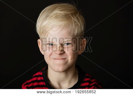 Angry Little Blond Boy Screwing Up His Face