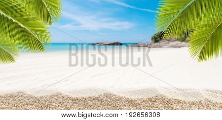 Sandy tropical beach with palm leaves frame and small island of andaman sea on backgroundconcept summer holiday background