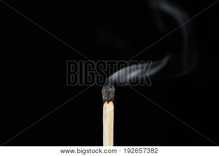 Close-up Of A Smoking Matchstick, Isolated On White Background.