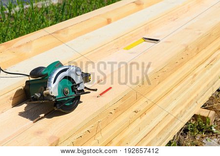 Carpenter Uses A Circular Saw To Cut Wood On The Work Area