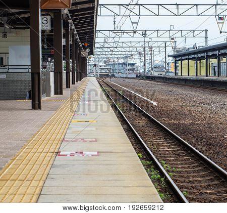 Morning time of Japanese train platform at Beppu