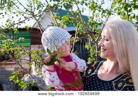 Mom With A Small Child In The Background Of Giving