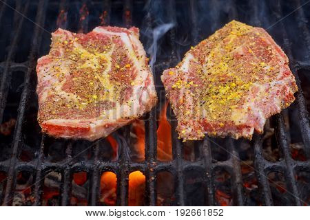 beef steak cooking over flaming grill Steaks grill on fire