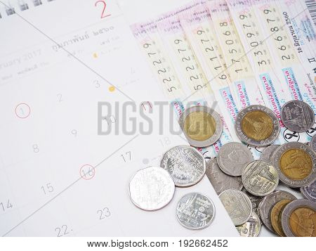 Close up Thai lottery tickets and Thai calendars with red marked of check out lottery date