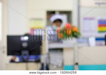 Out of focus of Doctor and nurse waiting for patient at counter hospital background