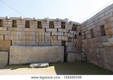 Collapsed stone walls at the Machu Picchu Ruins, Peru