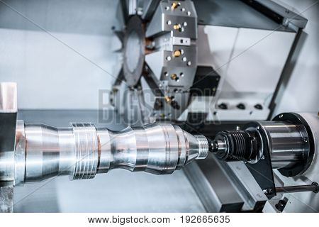 Machining of parts on a lathe. Abstract industrial background. Tinted in cold industrial colors.