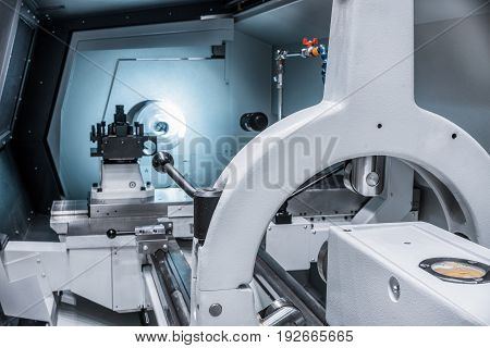 Working area of modern lathe metalworking CNC machine.