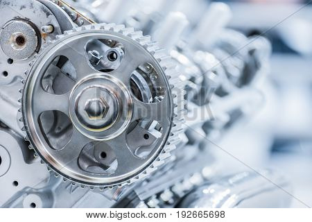 Gear of drive of a gas-distributing mechanism of the automobile engine. Cold undustrial color.