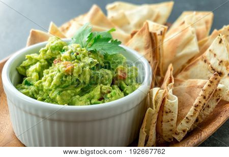 Mexican guacamole dish. Guacamole is a avocado based dip traditionally a mexican (Aztecs) dish. Healthy and easy to make at home with a few simple ingredients. Excellent as party food or at bars..