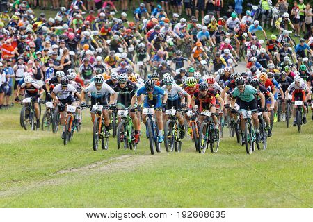 STOCKHOLM SWEDEN - JUNE 11 2017: Large group of fighting mountainbike cyclists in a cluster at Lida Loop Mountainbike Race. June 11 2017 in Stockholm Sweden