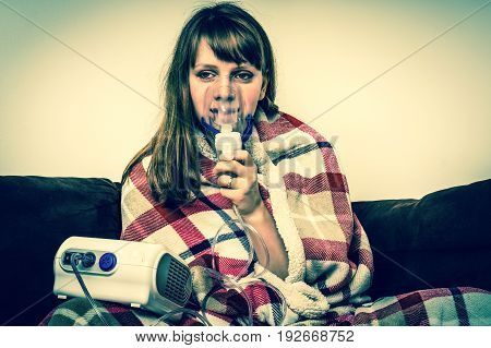 Woman With Flu Or Cold Symptoms Making Inhalation