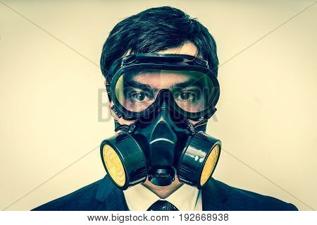 Businessman With Gas Mask Isolated On White