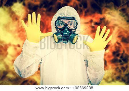 Man in coveralls with gas mask is showing stop gesture - nuclear and biohazard concept - retro style