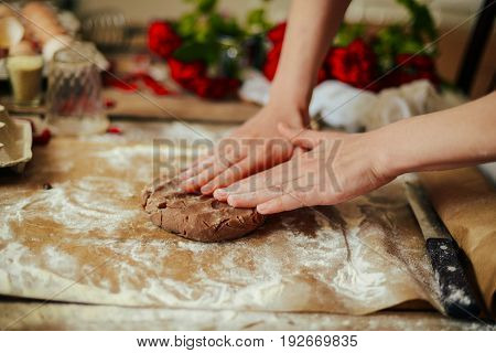 Hands Cut Cookie From Raw Dough On A Wooden Table. Healthy Baking Ingredients - Flour,  Butter, Eggs
