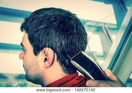 Hairdresser Cutting Hair With Electric Hair Clipper - Retro Styl