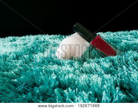 nail polish bottle with a cleanser on the blue carpet