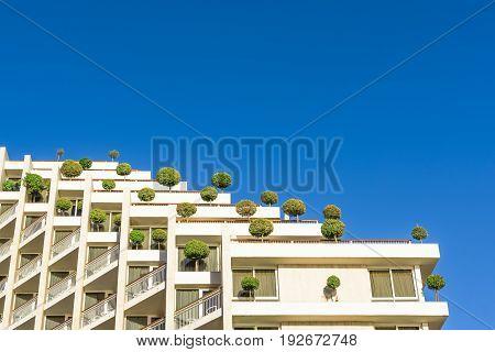 Floors of a modern building, like steps descending into the blue sky.