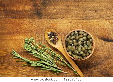 marinated pickled capers on a wooden background