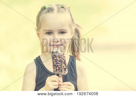 kid in the field eating ice cream