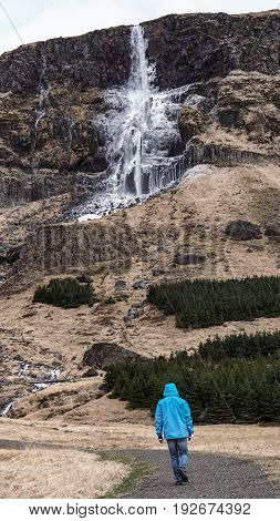 Advature Man Human Scale With Majestic Waterfall Mountain Size. Wonderful World Of Nature