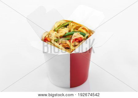 Glass rice noodles wok with vegetables in  box on a white background