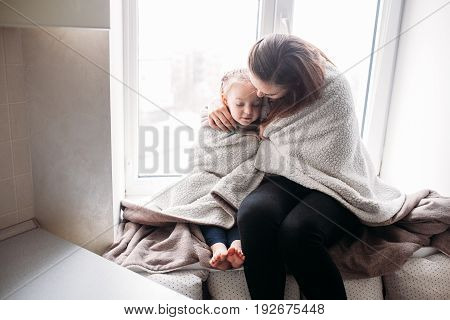 Happy loving family. Young mother and her daughter girl play in kids room