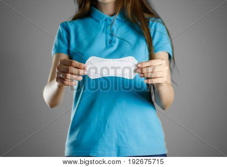 Girl Holding A Sanitary Pad. Closeup. Reports Daily Sanitary Pad. Isolated