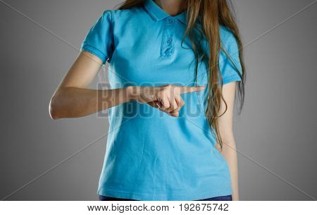 The Girl In Blue T-shirt Pointing Finger On The Right. Specifies The Direction. Isolated