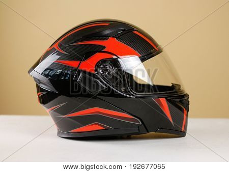 Beautiful Black With Red Motorcycle Helmet. With A Transparent Visor. Closeup. Isolated