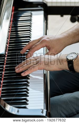 Music Performer Hands Playing Grand Piano