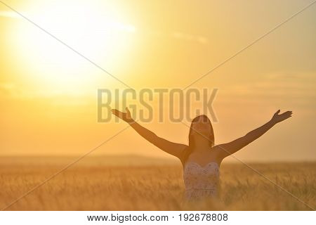 Woman Feeling Free, Happy And Loved In A Beautiful Natural Setting At Sunet