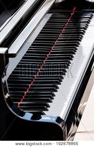 Black Grand Piano For Musicians With Reflections
