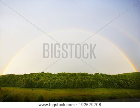 The rainbow above the forest and field