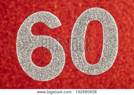Number sixty silver color over a red background. Anniversary. Horizontal